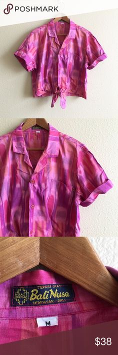 70s / Orchid Bali Crop Fuchsia/orchid batik men's shirt. Cut cropped & tied in front, edges finished.   BRAND: Bali Nusa MATERIAL: 100% cotton YEAR/ERA: 70s LABEL SIZE: M BEST FIT: M  MEASUREMENTS: Chest 20.5 inches Length 19 inches  → Style inspiration: Demi Moore, 1980s ☒ I do not model or trade, sorry! ❁ Check out my closet for more vintage! Vintage Tops Crop Tops