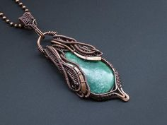 Beautiful chrysoprase pendant wrapped in a free form style with bare copper wire and a lovely teardrop bio chrysoprase cabochon. I had fun playing with the asymmetrical part . Size: 30mm (1.18in) at its widest point and 86mm (3.38in) in length. Weight: 23.4g The pendant has had a