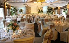 The tables were dressed with a combination of high and low table designs all on glass columns the tallest were 95cm tall from LSA with huge fresh Flower  & foliage Bombs on top