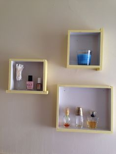 Repurposed drawers from an old desk to use as bathroom shelves.