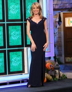 LA FEMME: Navy jersey gown w/front neckline, back, cap sleeves in navy illusion covered in navy re-embroidered lace and navy rhinestones, v-front, keyhole cutout back, skirt slit front-left, flared | Vanna White's dresses | Wheel of Fortune