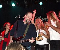 Cynthia and Jaime on stage with the band at TOADS...we know how to party all day!!!