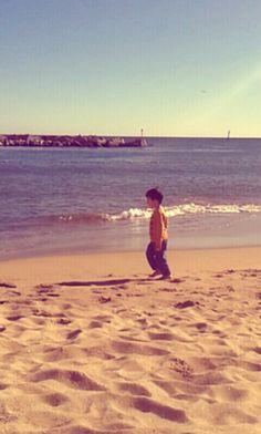 Little boy on Barceloneta beach