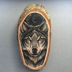 Wood slice with an original drawing of a wolf door Inkspirednl