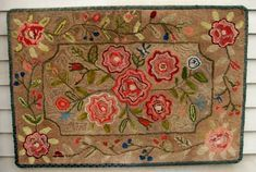 EARLY FLORAL SHEARRED HOOKED RUG, Maine. Mid to late 19th century. 26.5'' x 39''