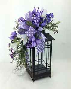 Easter Lantern Decorations, Easter Lantern Swag with Lilies in Purple & Lavender, Lantern Decoration Ideas, Decorating With Lanterns Lantern Centerpieces, Lanterns Decor, Decorating With Lanterns, Lanterns With Flowers, Lantern Designs, Christmas Lanterns, Easter Wreaths, Spring Wreaths, Spring Crafts