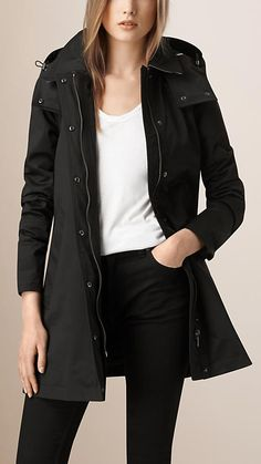 Burberry Black Showerproof Car Coat with Removable Warmer - A showerproof car coat in cotton-blend twill. Complementing the A-line silhouette, the coat features raglan sleeves, for softly rounded shoulders, and a back vent for volume and movement. Discover the women's outerwear collection at Burberry.com