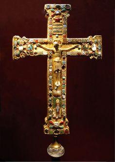 The Cross of Mathilde, a crux gemmata made for Mathilde, Abbess of Essen (973–1011), who is shown kneeling before the Virgin and Child in the enamel plaque. The body of Christ is slightly later. Probably made in Cologne or Essen, the cross demonstrates several medieval techniques: cast figurative sculpture, filigree, enamelling, gem polishing and setting, and the reuse of Classical cameos and engraved gems.
