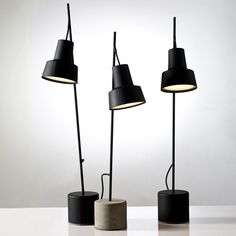 Tel Aviv designer Nir Meiri has created a set of table lamps with metal shades hanging from thin stalks.