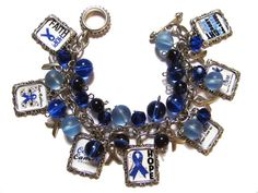 Colon cancer awareness altered art charm bracelet with all glass beads in shades of blue. I Love My Daughter, Colon Cancer, Cancer Awareness, Glass Beads, Charmed, Color Boards, Fundraising Ideas, Pressed Glass