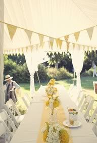 The head table will have tin pails filled with white hydrangeas, yellow spider mums, and yellow craspedia surrounded by mason jars holding the bridesmaids' bouquets, tin cans with green succulents and votives.