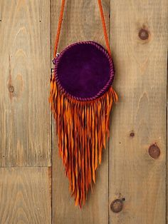 gorgeous suede crossbody purse with fringe from free people in love with the purple and orange mix of colors.! <3
