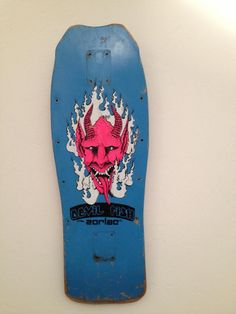 Simple and creepy design that fits neatly at the center of this board. It has a very Japanese demon feeling to it, so it's a street demon. It pops out with the color scheme and white flames behind it.   Less is more with this board.