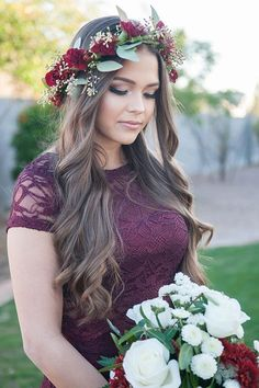 Bridesmaid wearing a burgundy lace dress and a jewel-toned floral crown made out of dahlias and seeded eucalyptus via Unfading Beauty Photography / http://www.deerpearlflowers.com/wedding-hairstyles-with-flower-crowns/2/