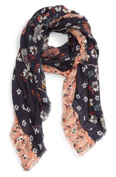Flowers tumble across this supersoft scarf trimmed with a contrast floral print and feathery eyelash fringe.