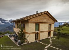 Lisa and Louis took 250 tons of CO2 from the atmosphere and locked it into the walls of their straw bale guesthouse in the beautiful alpine valley of Val d'Herens in Switzerland. The guesthouse and home was designed by architect Werner Schmidt who builds many homes from big bales 1.2 m (4ft) thick. Such big bales mean the house is extremely well insulated. Find out more at www.naturalhomes.org/maya.htm