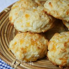 Garlic Cheese Drop Biscuits---An easy baking mix biscuit based on the Red Lobster Cheddar Bay biscuit copycats, made with sharp cheddar cheese and melted butter, infused with fresh garlic.