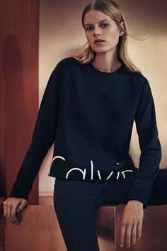 Spend the holidays in #mycalvins with the iconic logo cropped sweatshirt from Calvin Klein Jeans.