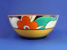 FLOREAT - large orange flowers with green and clear leaves on a black ground. Bizarre c1930