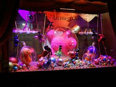 """A World Tour of Holiday Window Displays--Galeries Lafayette Haussmann--Paris, France--""""Noel Monstre"""" that's """"Monster Christmas""""--Strange fuzzy beasts have taken over the windows are filled with fluffy, googly-eyed abominations dancing in tutus and rolling around inside transparent ornaments. Inside, an 82-foot-high tree dangles upside-down from the iconic glass-domed ceiling"""