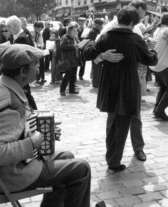 Every Sunday morning, come rain or shine there is a musette... an accordion player, singing and dancing on rue Mouffetard.