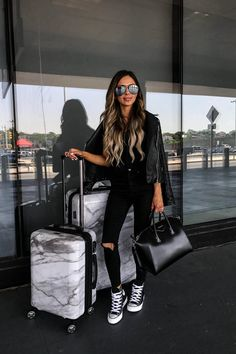 fashion blogger mia mia mine wearing a casual all black outfit while traveling with the calpak marble luggage 2 piece set. click through to see more chic airport outfits, how to travel in style, fashion blogger travel outfits, and more. #travelblogger #airportstyle #jetsetter #casualootd Airport Travel Outfits, Airport Style, Airport Chic, Winter Travel Outfit, Winter Outfits, Couple In Love, Airplane Outfits, Botas Sexy, Wearing All Black