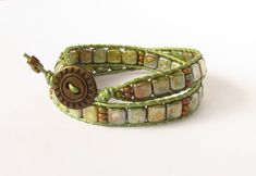 SOLD!!!!!!  Double wrap leather bracelet with metallic pistachio green leather and 2 hole Czech glass tila beads.
