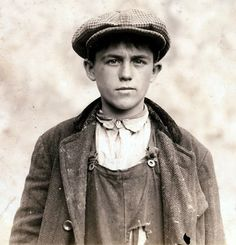 SENDING A MESSAGE: An unnamed messenger boy, taken in 1915. The expression is a hard look. He is Irish Immigrant teenager in Massachusetts, 1916. [Digitally colorized image on the board]