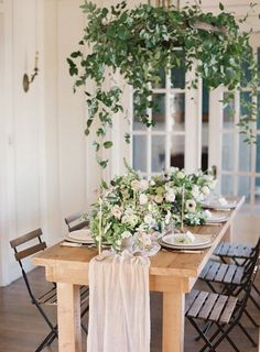Pastel Spring Wedding Inspiration | Wedding Sparrow hanging foliage over table with silk runner That silk table runner is gorgeous