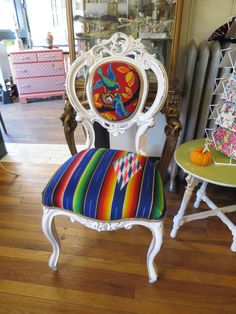 "So, what do you do when you have an over-abundance of vintage and antique textiles? You start a line of upholstered furniture! My very first Weekend Gypsy ""Ravishing Rubbish"" custom designed vintage chair...upholstered with a vintage bird and nest needlepoint and a beautiful antique Mexican serape."