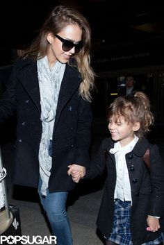Heading Home: Jessica Alba held on to her daughter Honor as they touched down at LAX on Wednesday.