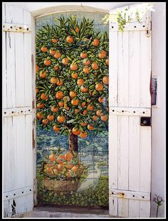 Painted tile trompe l'eoil by Katherine Swift - would be beautiful in a little nook in the garden.