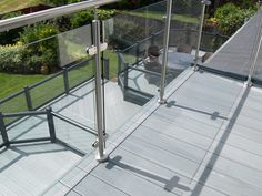 Fensys UPVC decking with matching balcony and glass panelling Plastic Fencing, Decking Suppliers, Caravan Holiday, Glass Railing, Led Manufacturers, Plastic Glass, Panelling, Glass Panels, Fence