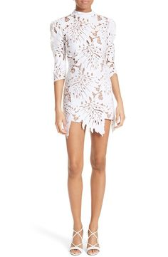 Laser-cut palm leaves pattern this pristine lace sheath with sweetly puffed sleeves and a tempting stylized hemline.