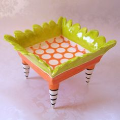 funky orange ceramic dish with striped legs. $68.00, via Etsy.