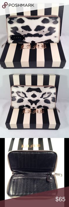 L.A.M.B. Snow Leopard Zip Wallet♥️1 DAY SALE💥 Gorgeous zip around wallet in excellent condition. Designed by Gwen Stefani. Silver hardware. Authentic and smokefree. No box. Please see all photos and ask any questions prior to purchase.💋 L.A.M.B. Bags Wallets