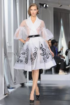 Has a fifties look. Haute couture 2012-Karlie Kloss walks the runway for Dior