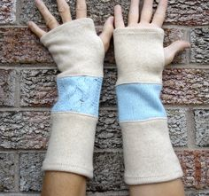 Upcycled arm warmers, fingerless gloves, recycled from blended wool light blue cable knit and felted cream lambswool sweaters. $24.95, via Etsy.