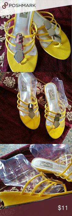 Yellow wedge sandals Victoria Spencer Yellow strappy sandals has a small wedge heel & silver  decorative pieces down front. Worn once or maybe twice, but in very good condition. Victoria Spencer  Shoes Sandals