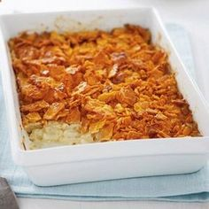 Classic Cheesy Potatoes: 1 can (10-3/4 ounces) condensed cream of chicken soup. 1-1/2 cups sour Cream. 1 pkg (32 ounces) frozen Southern-style hash browns, thawed. 1 package (8 ounces) sredded Sharp Cheddar Cheese. 20 RITZ Crackers, crushed (about 1 cup). 2 tablespoons butter, melted. .
