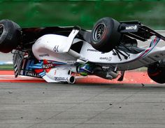 Massa (Williams F1) flipped upside down at the 2014 Formula One Grand Prix of Hockenheim (Germany) after he was rear ended by Magnussen (McLaren)
