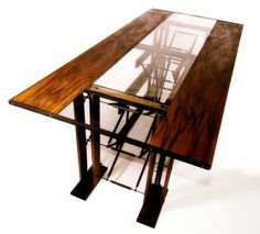 Industrial dining room table made of wood, metal and glass