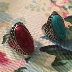 Red  and turquoise stone rings Two medium size rings , in red and turquoise stones based on silver tone metal . Post find but it's to big for me . Jewelry Rings