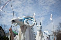 White puppets, representing spirit beings carrying prayers for the world, at the HOBT May Day parade.