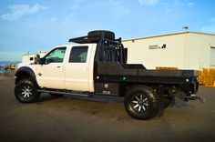 2015 Ford F350 Aluminum Flatbed in Leopard style (hpi black w/ shaved diamonds) with matching underbody boxes, mud flaps, and an over cab tire rack. Sweet Ride!