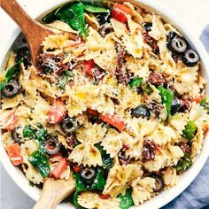 Tuscan Pasta Salad is an easy pasta salad with sun dried tomatoes, peppers spinach, and olives tossed in a tangy dressing.  Perfect for your next potluck!
