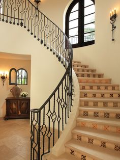 Lighter floor treatment, beautiful wrought iron with card suits?