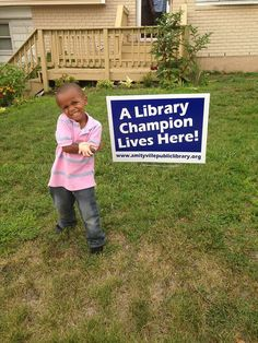 Upon completion of the Summer Reading Program kids are awarded a special Library Champion sign for their achievements