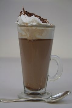 Hot Chocolate Grand Marnier:  1.25 oz. Milk Chocolate discs, Albert Uster Couverture (amount equivalent to 1 butter ramekin)  .5 oz. Grand Marnier  Steamed whole milk  Build the drink into a latte mug, top ith steamed whole milk and stir until fully incorporated. Garnish with whipped cream and chocolate shavings. Cheers!