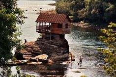 Back in 1968, a small group of young boys decided that their sunbathing rock needed a comfortable place to relax, using boats and kayaks to transport boards from a nearby ruined shed to build this beauty. Over the past few decades, the house has been destroyed multiple times in floods, but just like that it gets built right back up.